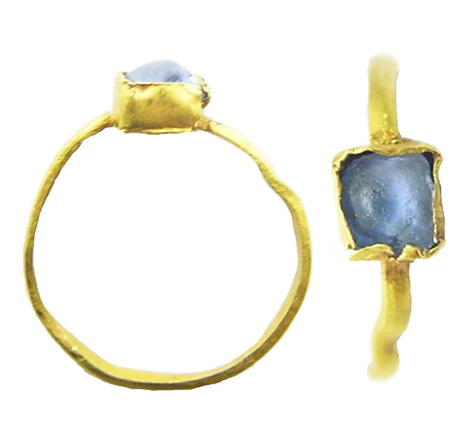 Medieval gold penny ring set with blue glass gemstone