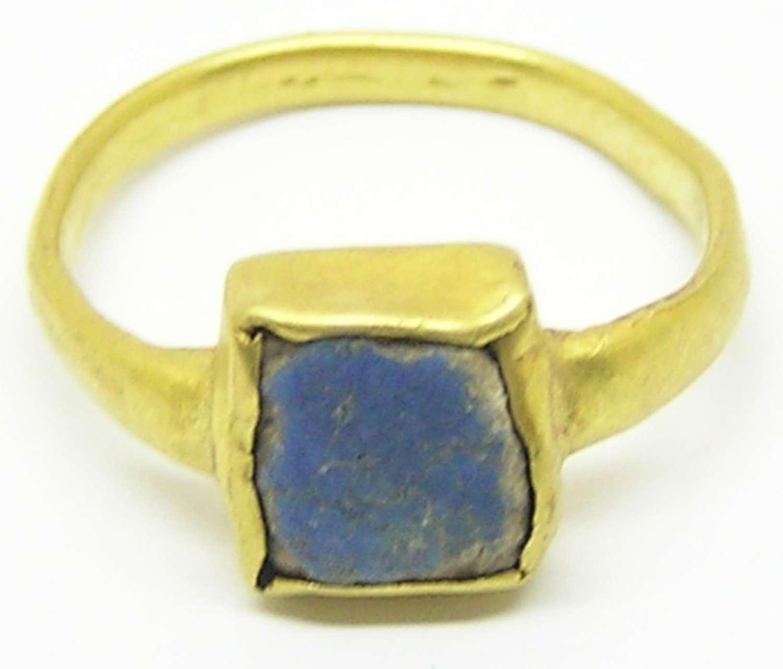 Medieval gold ring set with lapis lazuli gemstone
